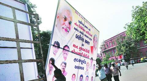 Political hoardings are pulled down in Vadodara as the Model Code of Conduct comes into effect on Wednesday. Bhupendra Rana