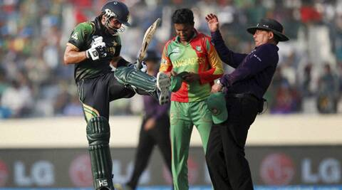 Ahmed Shehzad, left, celebrates scoring a century during Pakistan's match against Bangladesh in Dhaka. (AP)