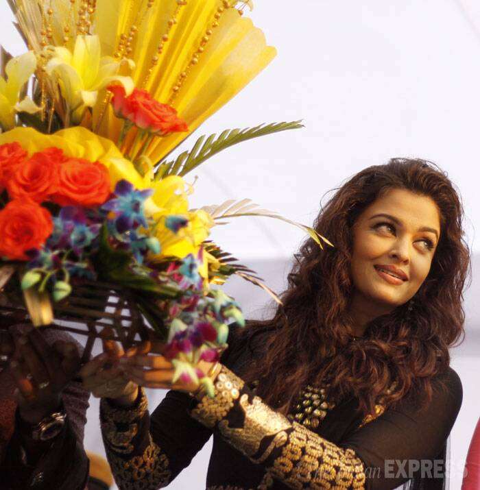 Aishwarya is greeted and welcomed with beautiful flowers. (IE Photo: Praveen Khanna)
