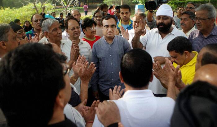 Congress Leader and New  Delhi Lok Sabha  candidate Ajay Maken interacts with morning walkers during his  campaign at Lodi Gardens in New Delhi on Saturday. (PTI)