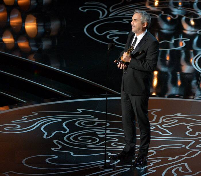 "Alfonso Cuaron accepts the award for best director of the year for ""Gravity"" during the Oscars at the Dolby Theatre on Sunday, in Los Angeles. (AP)"