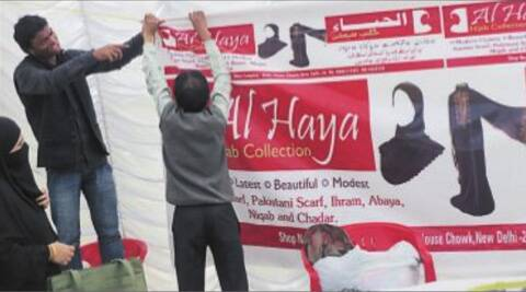 'Students of AMU' putting up a purdah banner on Friday.