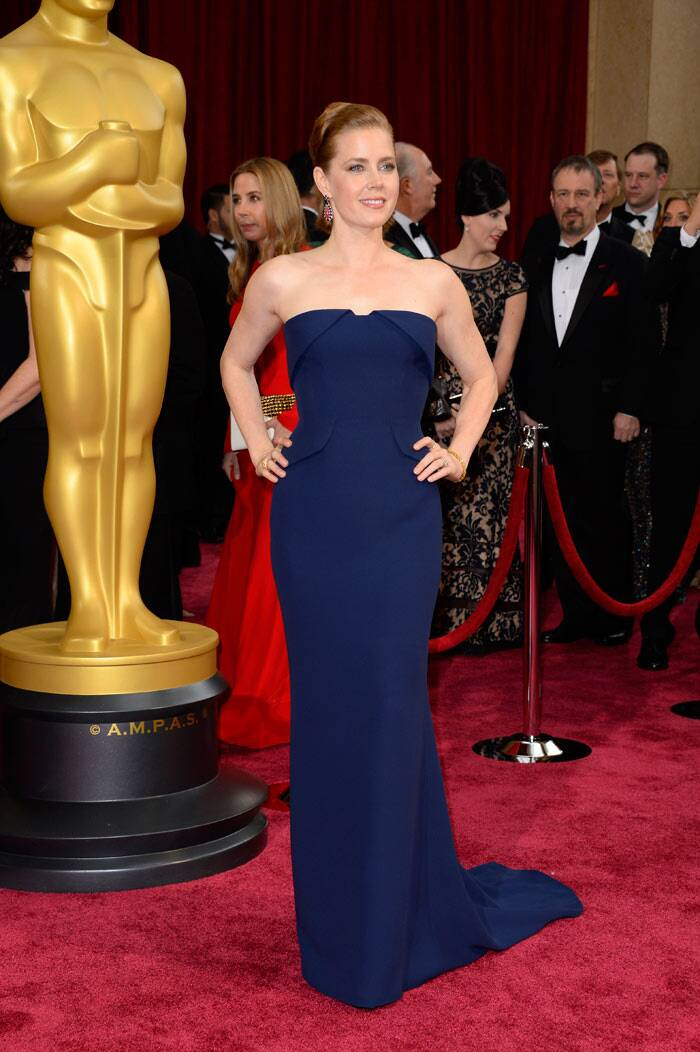 'American Hustle' beauty Amy Adams was stunning in a beautiful sapphire strapless tuxedo-inspired Gucci gown. (AP)