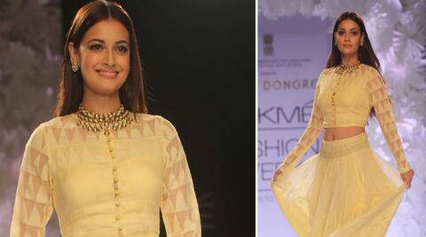 Dia Mirza glided down the catwalk in a lemon lehenga and long-sleeved blouse.