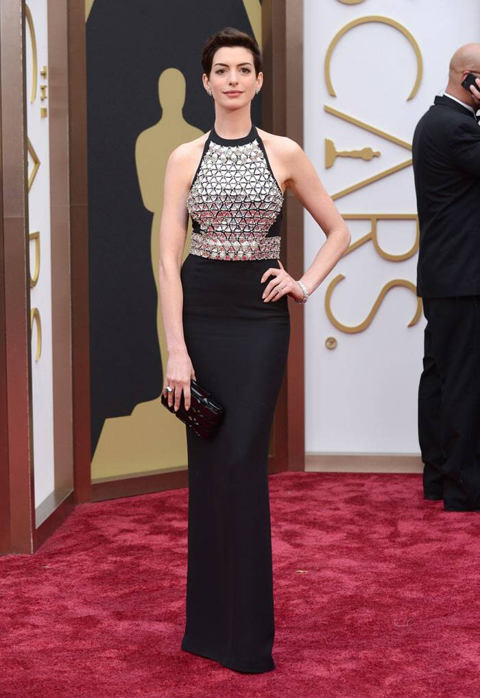 Anne Hathaway picked black for the night but added some glam with metallic detailing. (AP)