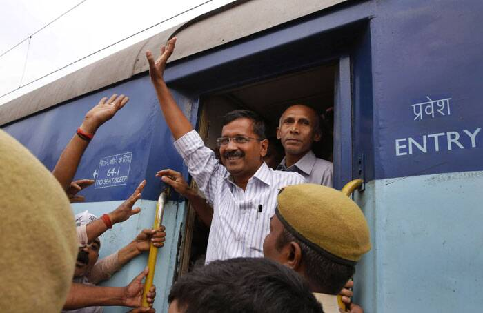 Aam Aadmi Party (AAP), or the common man's party chief Arvind Kejriwal waves to supporters as he arrives in a train for election campaign in Varanasi. India will hold national elections from April 7 to May 12, kicking off a vote that many observers see as the most important election in more than 30 years in the world's largest democracy. (AP)