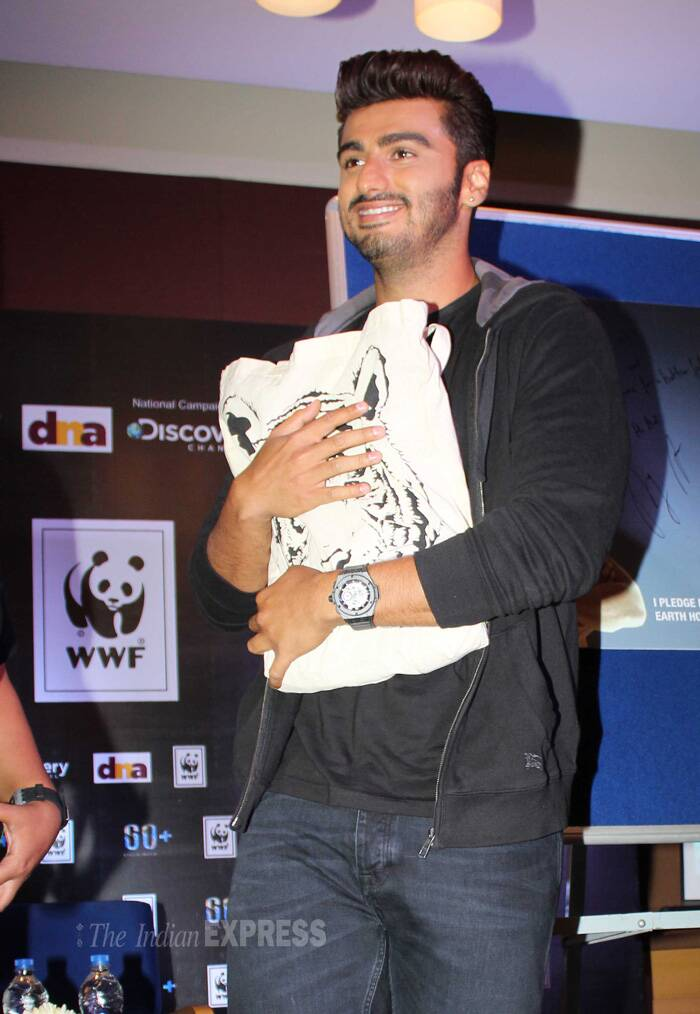 Arjun is all smiles as he holds his bag close…Wonder what's in it! (Photo: Varinder Chawla)