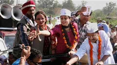 AAP convener Arvind Kejriwal with party candidate Gul Panag during an election campaign in Chandigarh on Sunday. (PTI)