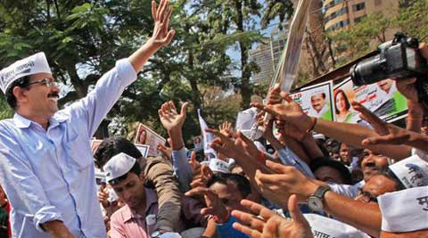 Mumbai:Aam Aadmi Party (AAP) chief Arvind Kejriwal waves during a road show in Mumbai on Wednesday. (PTI Photo)