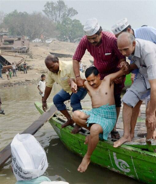 AAP convener Arvind Kejriwal taking holy dip in River Ganga at Rajghat in Varanasi on Tuesday. (PTI)