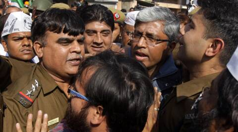 Aam Aadmi Party leader taken to the Parliament Street police station for questioning in connection with violence clashes outside the Bharatiya Janata Party office in Delhi on Wednesday.(Express Photo: Amit Mehra)