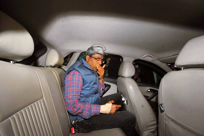 AAP leader Ashutosh leaves after being questioned by the police at Mandir Marg police station in New Delhi on Thursday in connection with party volunteers' clashes with BJP workers. (PTI)