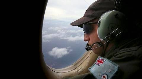 Airborne Electronics Analyst Ben Herbert on board a Royal Australian Air Force AP-3C Orion, looks out of the window during a search for the missing Malaysia Airlines Flight 370 in the southern Indian Ocean. (AP)