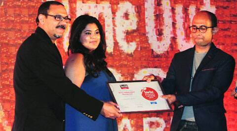Irfan Pabaney and Rachel Goenka of The Sassy Spoon receive their award for Best Independent Restaurant from Jaideep Giridhar, Editor-in-Chief, Time Out India.