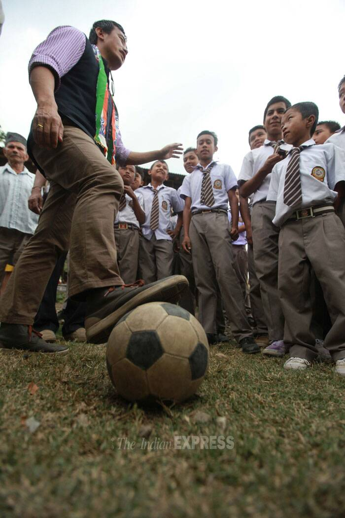 Children listen to Baichung carefully while he gives them lessons on soccer.  (IE Photo: Subham Dutta)