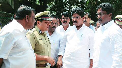 BJP leaders inquire about the case from police personnel in Bangalore on Wednesday.www.pics4news.com