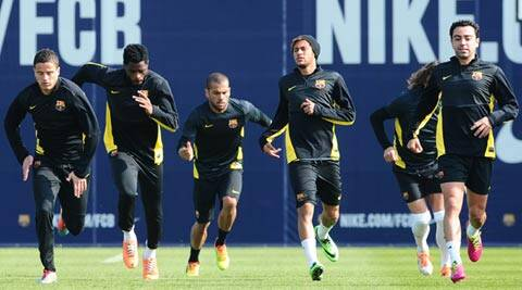 FC Barcelona's Ibrahim Afellay, Alex Song, Daniel Alves, Neymar and Xavi Hernandez at a training session before the second-leg of their last-16 Champions League match (AP)