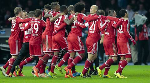 Players of Bayern Munich celebrate their victory over Hertha Berlin in  their Bundesliga final clash. (AP)