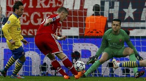 Bayern Munich's Bastian Schweinsteiger (C) scores a goal against Arsenal's Lukasz Fabianski during their Champions League round of 16 second leg match (Reuters)