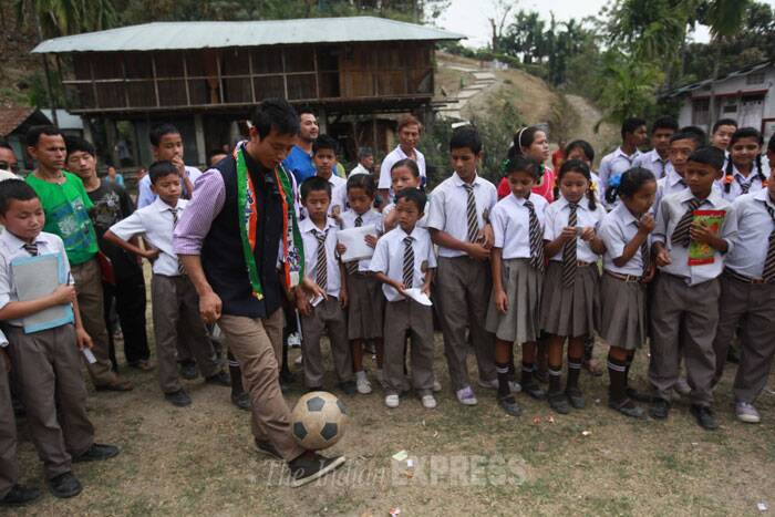 Baichung is seen playing football with a bunch of kids in his constituency. (IE Photo: Subham Dutta)
