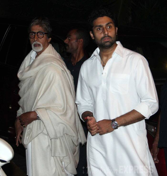 Amitabh Bachchan and son Abhishek arrived together to pay their respects. (Photo: Varinder Chawla)