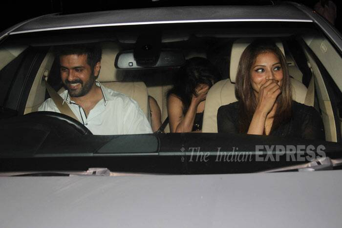 Is she blushing? Bipasha can't hide her smile as she gets into the car with Harman. (Photo: Varinder Chawla)
