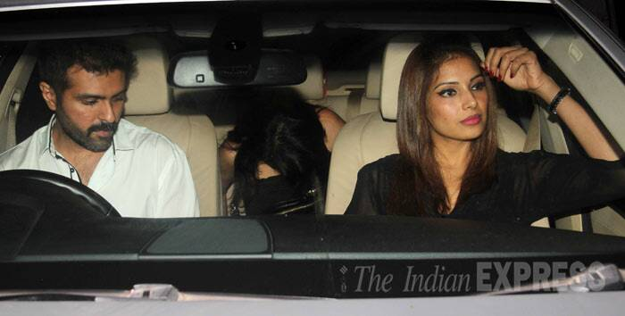 Bipasha and Harman's friend doesn't want to be clicked. We wonder who she is? (Photo: Varinder Chawla)