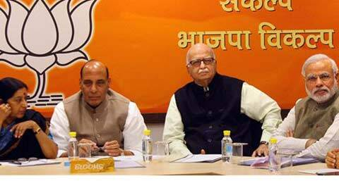 BJP President Rajnath Singh, party's Prime Ministerial candidate Narendra Modi, LK Advani and Sushma Swaraj at a meeting of the party's Central Election Committee (CEC), in New Delhi on Saturday. (PTI Photo)