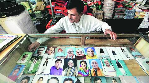 A man sells pictures of senior BJP leaders outside party headquarters in Delhi on Wednesday. Ravi Kanojia.