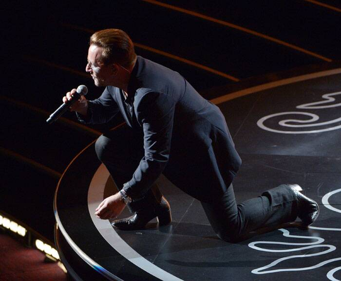 Bono of U2 gets on the floor while performing during the Oscars at the Dolby Theatre. (AP)