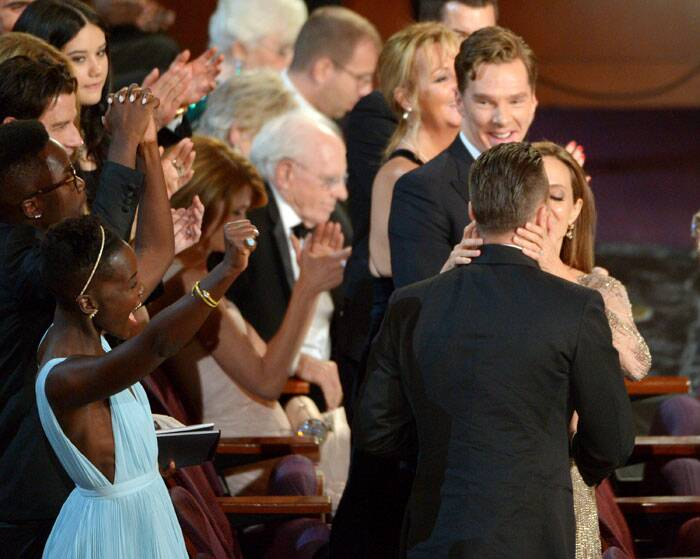 Angelina Jolie congratulated Brad Pitt with a kiss as he won his first Oscar, with '12 Years a Slave' snagging best picture at the 2014 Academy Awards.