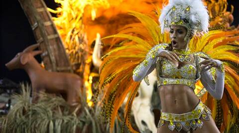 A performer from the Vila Isabel samba school parades during carnival celebrations at the Sambadrome in Rio de Janeiro, Brazil. (AP)