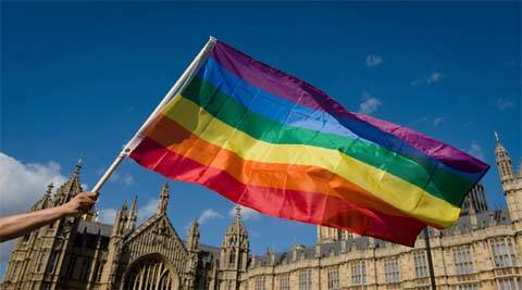 The rainbow flags are being raised Friday ahead of the law taking effect on Saturday. (AP)