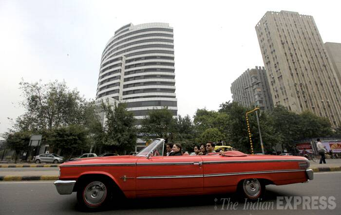 Here comes the swanky long red vintage car. (IE Photo: Ravi Kanojia)