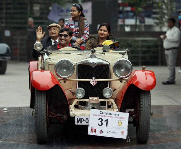Participants in their vintage car during Statesman Vintage car rally in New Delhi on Sunday. (PTI)
