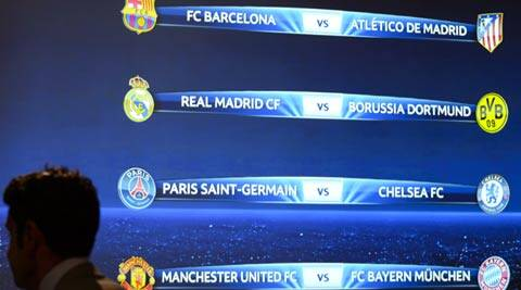 The match fixtures are shown on an electronic panel  after the draw of the quarterfinals of UEFA Champions League 2013/14 at the UEFA Headquarters in Nyon (AP)