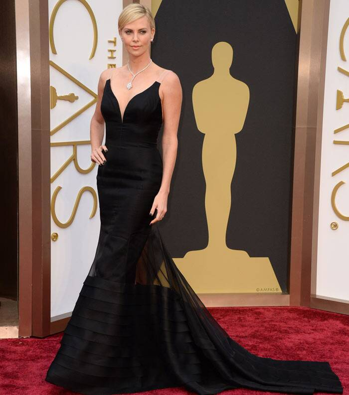 Charlize Theron was stunning in a black Christian Dior haute couture dress. Charlize will  be presenting an award at the Oscars. She wore Harry Winston jewels. (AP)