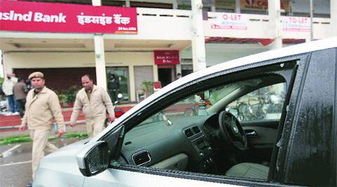 Panchkula Police inspect the spot after Rs 8 lakh was stolen from a car parked outside Indusind Bank in Sector 9, Panchkula, on Saturday. Jaipal Singh