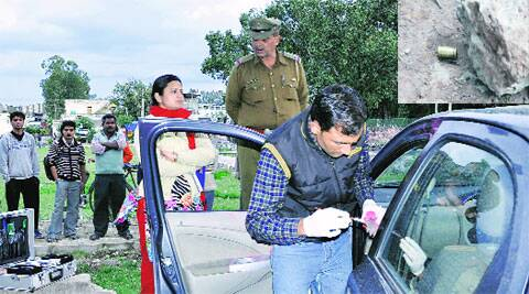 Policemen and forensic experts at the crime spot in Industrial Area, Phase 1, Panchkula, on Tuesday; (Inset) a shell