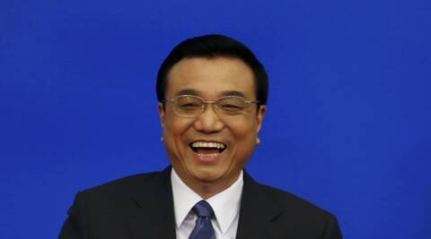 China's Premier Li Keqiang laughs after a news conference following the closing ceremony of the Chinese National People's Congress at the Great Hall of the People, in Beijing