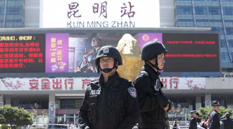 A group of militants armed with knives and swords attacked people randomly at the crowded Kunming railway station in China. (AP Photo)