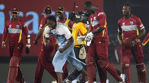 Gayle, who top-scored in WI's run chase, celebrates animatedly with his teammates after the win.  (Reuters)