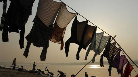 Dhobis earn a living using the resources they can muster, which are hard work, stamina and the skill of laundering. (AP)