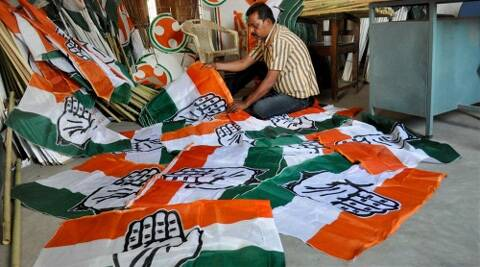 A Congress worker arranging party flags in Agartala on Thursday. (PTI)