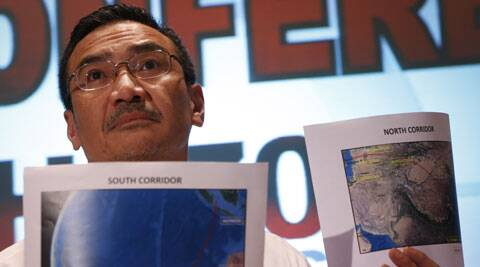 Malaysia's Transport Minister Hishamuddin Hussein shows maps of southern corridor and northern corridor of the search and rescue operation during a press conference at a hotel near the Kuala Lumpur. (AP)