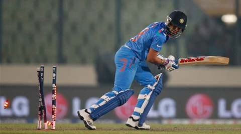 India's batsman Virat Kohli is bowled out during their ICC Twenty20 Cricket World Cup warm up match against Sri Lanka. (AP)