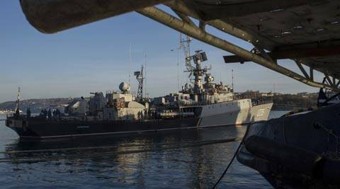 People stand aboard the Ukrainian navy corvette Ternopil vessel as it stands at harbor in Sevastopol. (AP)