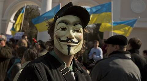 A pro-Ukrainian demonstrator wearing a mask attends a rally, in Simferopol, Ukraine, Saturday, March 15, 2014.