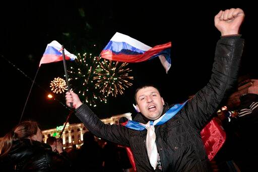 People celebrate in Lenin Square, in downtown Simferopol, Ukraine, Sunday, March 16, 2014.