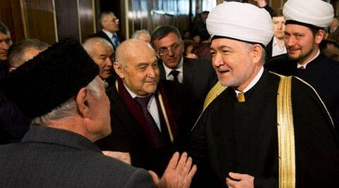 Crimean Tatars greet Russia's top Muslim Cleric Ravil Gainutdin, right, during the Crimean Tatar Qurultay, a religious congress, in Bakhchysarai. (AP)